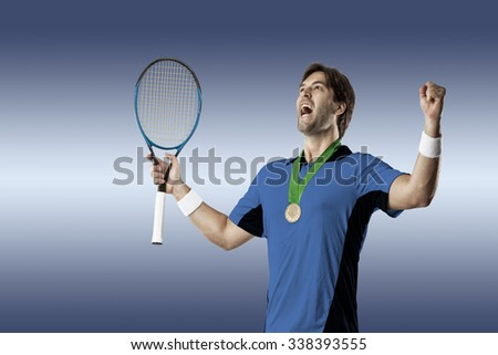 Tennis player with a blue shirt, celebrating with a gold medal, on a blue background. - stock photo