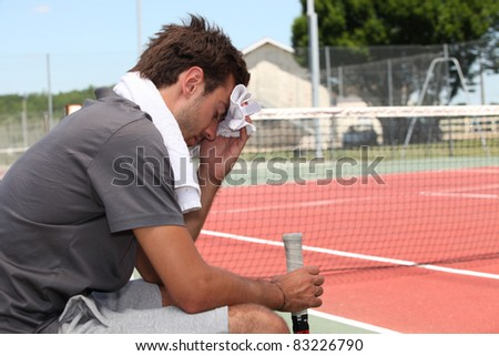 tennis player with towel - stock photo