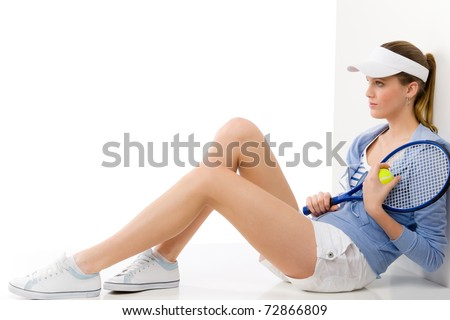 Tennis player - young woman with racket in fitness outfit - stock photo