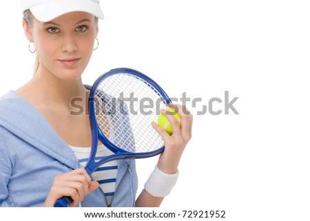 Tennis player - young woman with racket in fitness outfit