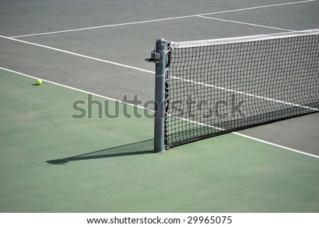 Tennis playground with a ball in the floor - stock photo