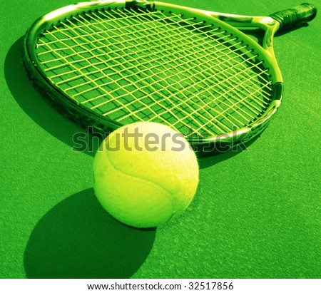 Tennis racket and  ball on training court,  sunny day