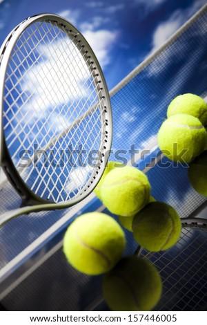 Tennis racket and balls - stock photo