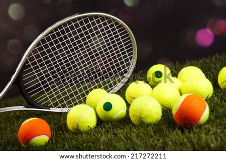 Tennis racket and balls - stock photo