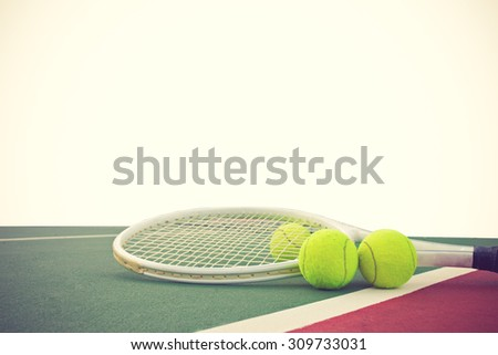 tennis racket and balls on white background vintage color - stock photo