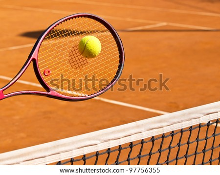 tennis racket and the ball - stock photo