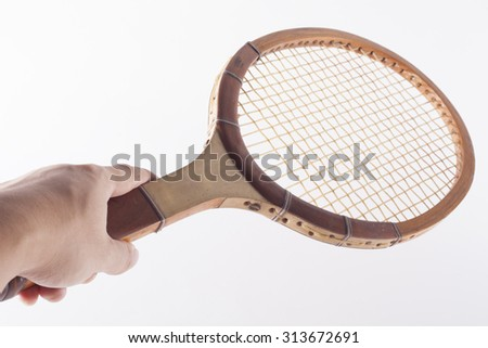 tennis racket in hand - stock photo