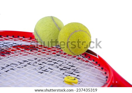 Tennis racket with two tennis balls isolated on white background - stock photo