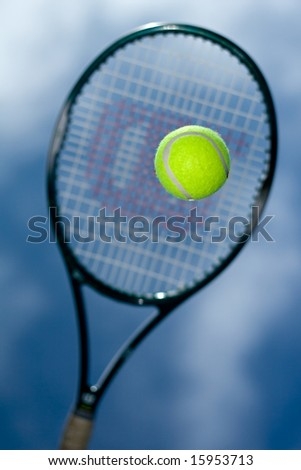 Tennis racquet and ball - stock photo