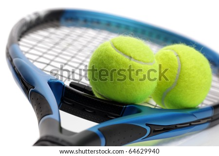 Tennis racquet and two balls on white background - stock photo