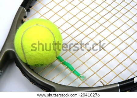 Tennis racquet head and yellow ball - stock photo