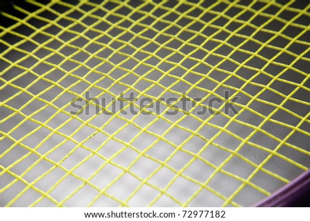 Tennis racquet isolated on the black background. - stock photo