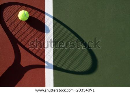 Tennis racquet shadow - stock photo