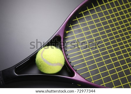 Tennis racquet with ball isolated on the background. - stock photo