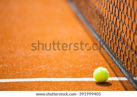 Tennis - tennis ball on a tennis court - stock photo
