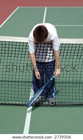 Tennis wipe-out - stock photo