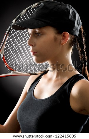Tennis woman portrait female player with racket on black background - stock photo
