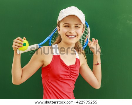 Tennis - young girl tennis player - stock photo