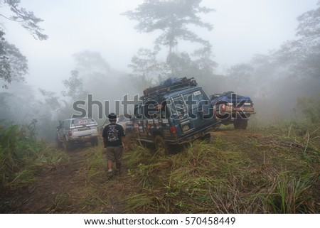 Tenom Sabah Malaysia - Oct 27, 2015 : Adventurer on 4X4 car during Borneo Safari Expedition in the jungle of Sabah Malaysian Borneo. Borneo jungle is popular tourism destination for outdoor adventure.