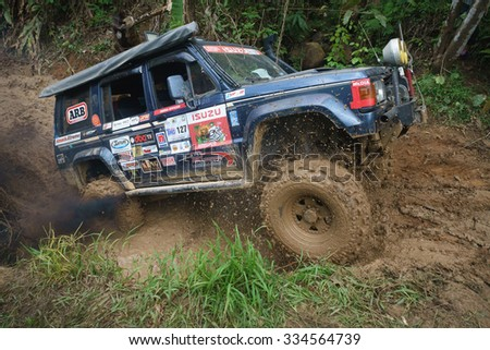 Tenom Sabah, Malaysia - Oct 26, 2015:An extreme 4X4 car passing a muddy trail of jungle route in the rainforest of Sabah Malaysian Borneo.Sabah jungle is popular for 4X4 adventures. - stock photo