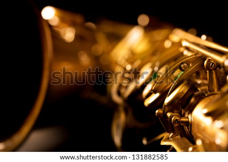 Tenor sax golden saxophone macro with selective focus on black - stock photo