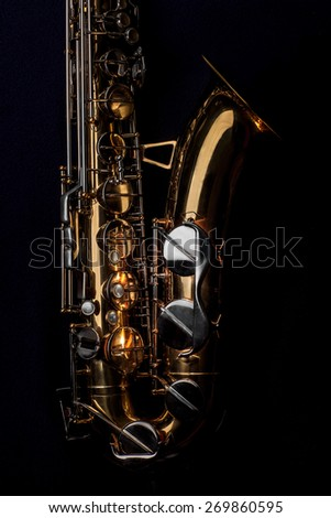 Tenor Saxophone isolated on a black background. - stock photo