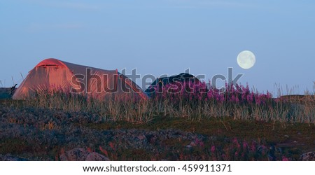 Tent and moon - stock photo