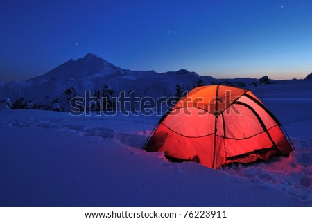 Tent and Mt Baker at sunset, camping at Huntoon Point - stock photo