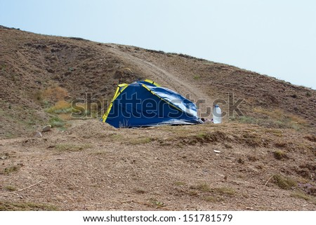 Tent at High Altitude Campsite in the Mountains,  the wind that shakes - stock photo