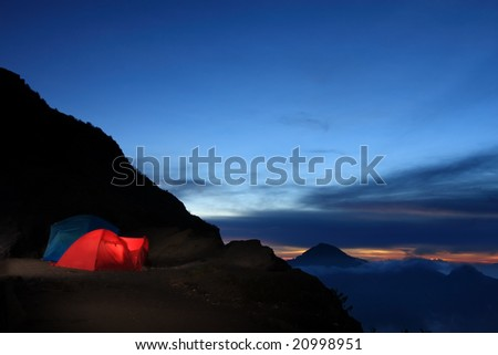 Tent camping in crater rim wilderness - stock photo