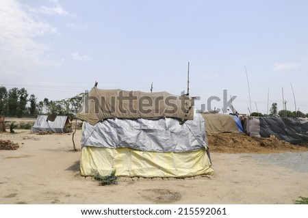 Tent cities for displaced communities in India. - stock photo