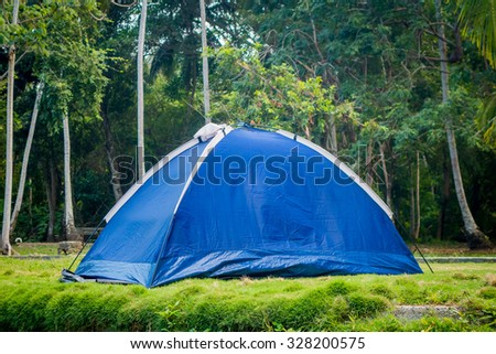 Tent in camping area in a tropical forest, Colombia - stock photo