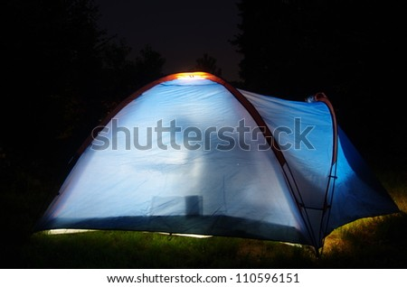 tent in night with people - stock photo