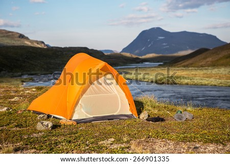 Tent in the evening sun in Sweden - stock photo