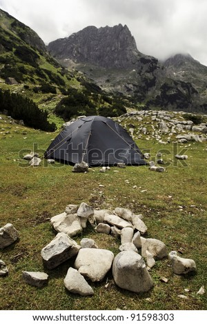 Tent into the wild and place for fire - stock photo