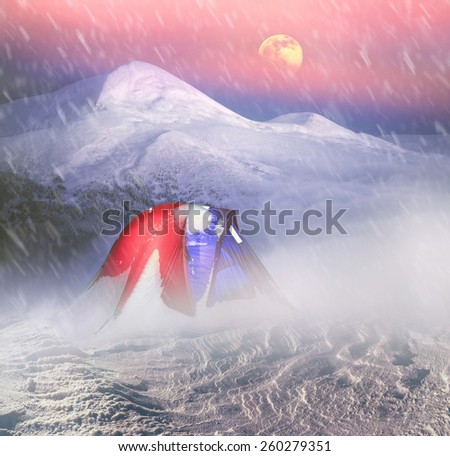 Tent on a snowy mountain top. - stock photo