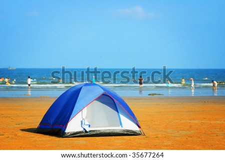 Tent on seashore in the morning - stock photo