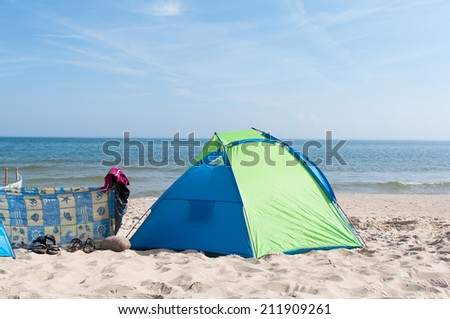 Tent on the beach on sunny day - baltic Poland - stock photo