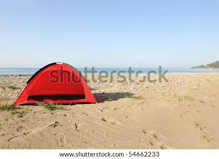 Tent on the beach waiting for you - stock photo
