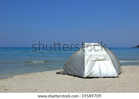 Tent on the beach waiting for you in Greece - stock photo
