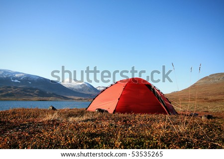 Tent on the long distance hiking trail Kungsleden in Lapland Sweden - stock photo