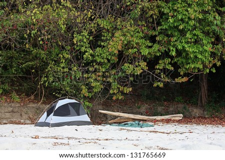 Tent on white sand beach for vacation - stock photo