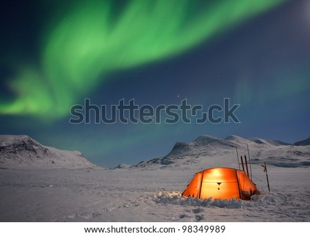 Tent under Northern Lights on a Expedition - stock photo