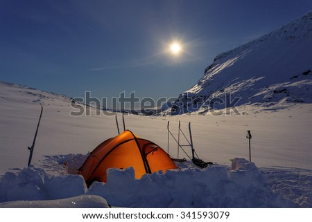 Tent under the moon - stock photo