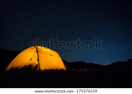 Tent under the stars - stock photo