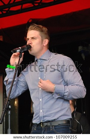 TENTERDEN, ENGLAND - JULY 1: Adam Chandler, British swing/rock singer, performs at the Tentertainment music festival on July 1, 2012 at Tenterden, Kent. In 2007 he was in reality show The X Factor. - stock photo