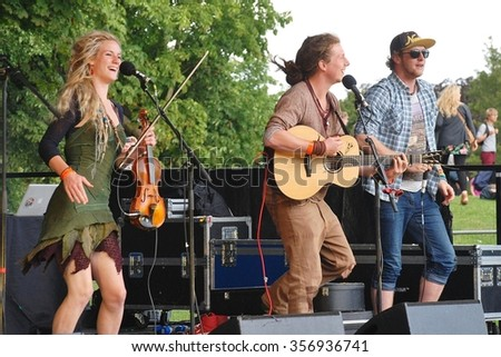 TENTERDEN, ENGLAND - JULY 6, 2014: British Fip Fok band Coco and The Butterfields perform live on stage during the annual Tentertainment music festival. The free, public event was first held in 2008.