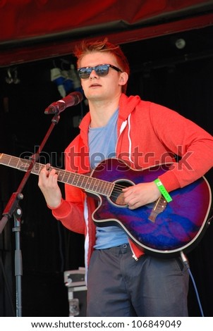TENTERDEN, ENGLAND - JUNE 30: Jake Allen, British singer/songwriter, performs at the Tentertainment music festival on June 30, 2012 in Tenterden, Kent. The annual festival was first held in 2008.