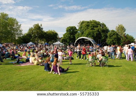 TENTERDEN, ENGLAND - JUNE 13: The audience watching the Tentertainment music festival on June 13, 2009 at Tenterden, Kent. - stock photo