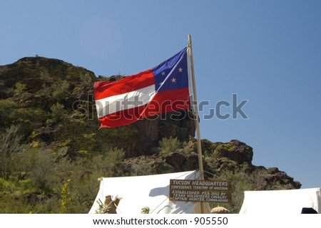 Tents and flag in a civil war encampment. - stock photo